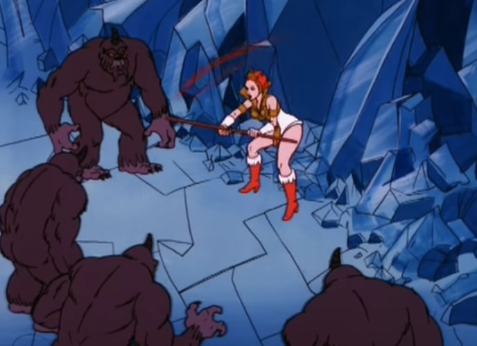 Teela fends off four shadow creatures, which are large, black and kind of rocky shaped.