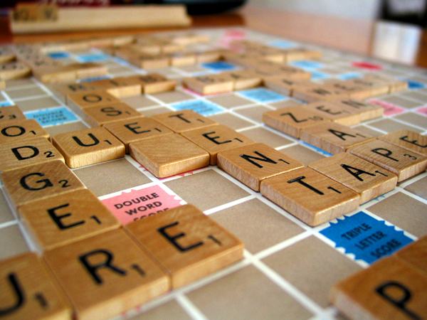 Scrabble tiles on a board. The words spelled out include DUET, TENT, TAPE and ZAP. (Photo by mydalliance via Flickr/Creative Commons https://flic.kr/p/LcT4C)