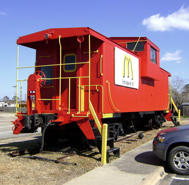 "A red caboose with the McDonald's ""golden arches"" logo on the side. (Photo by Patrick Feller via Flickr/Creative Commons https://flic.kr/p/7Jqn6R)"