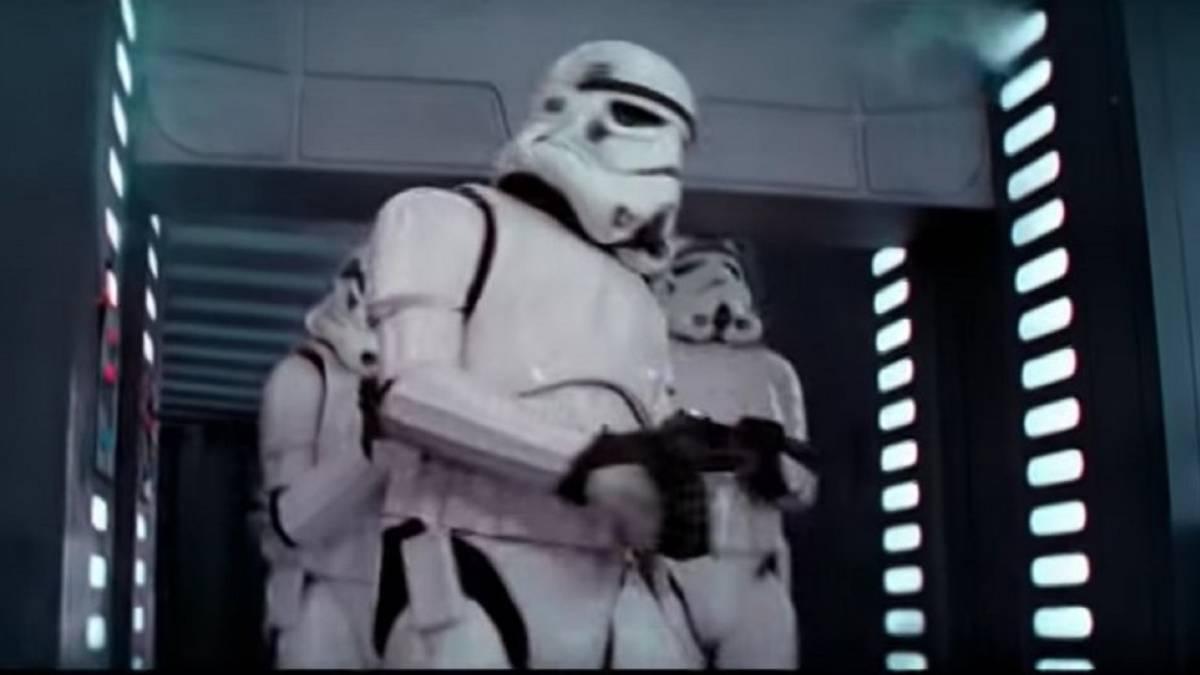 Stormtrooper bonks his helmet into the door as it opens