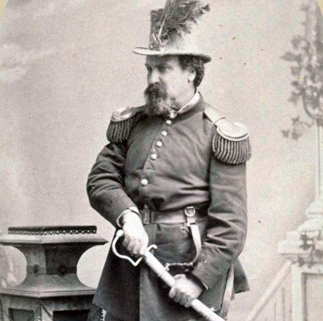 Emperor Norton in full dress uniform and military regalia, his hand on the hilt of a ceremonial sabre, c. 1875. (Photo via Wikicommons https://en.wikipedia.org/wiki/Emperor_Norton#/media/File:Emperor_Joshua_A._Norton_I.jpg)