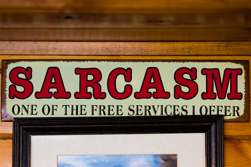 """Wall sign: """"Sarcasm: One of The Free Services I Offer"""" (Photo by Thomas Hawk via Flickr/Creative Commons https://flic.kr/p/2i2QWgQ)"""