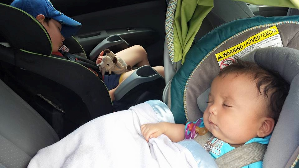 The Carlson boys are completely conked out in their car seats.