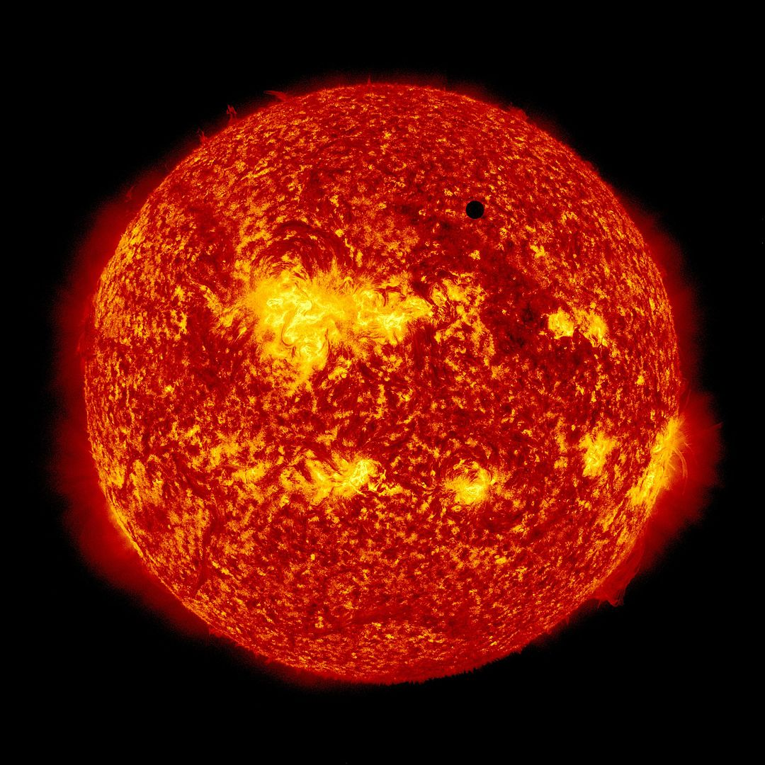 2012 transit of Venus as seen by NASA's Solar Dynamics Observatory spacecraft (Photo by NASA/SDO, AIA via Wikicommons/Creative Commons https://en.wikipedia.org/wiki/Transit_of_Venus#/media/File:SDO's_Ultra-high_Definition_View_of_2012_Venus_Transit_(304_Angstrom_Full_Disc_02).jpg)