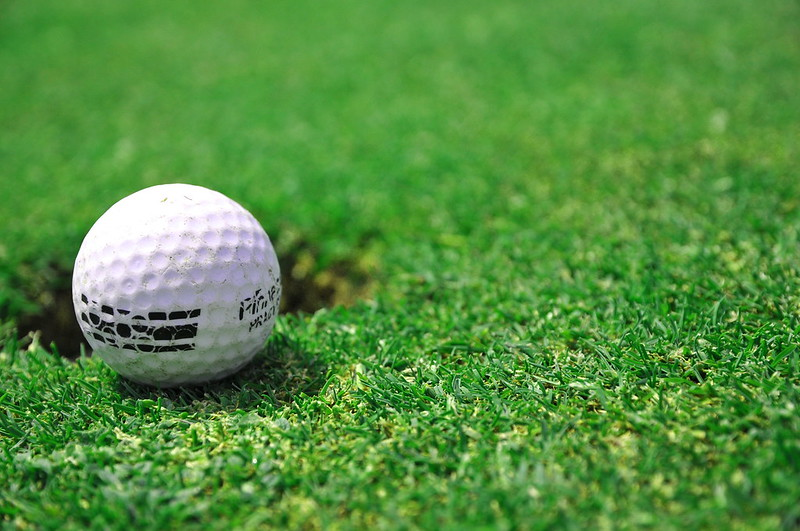 A golf ball is just shy of the hole. (Photo by Catalin Munteanu via Flickr/Creative Commons https://flic.kr/p/6xcL8p)