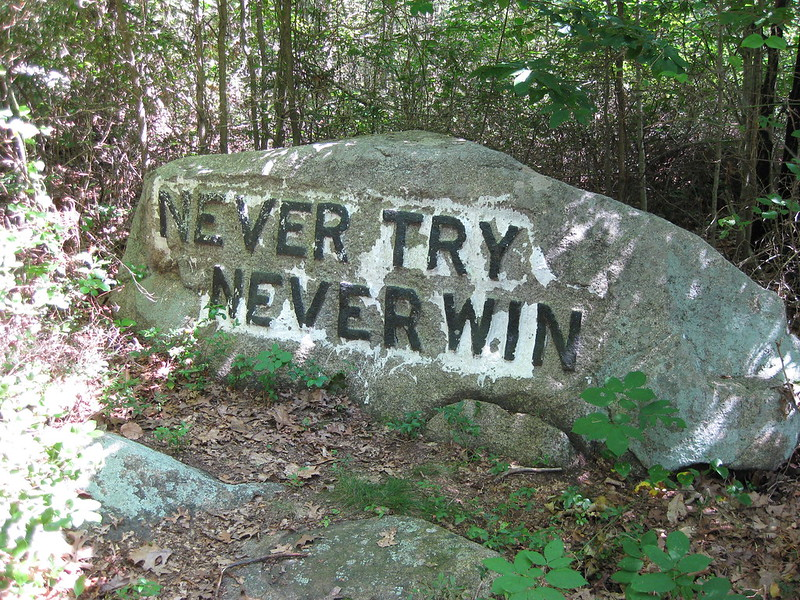 """A boulder with the words """"NEVER TRY NEVER WIN"""" inscribed on the front. (Photo by David Bruce via Flickr/Creative Commons https://flic.kr/p/5fWb3S)"""