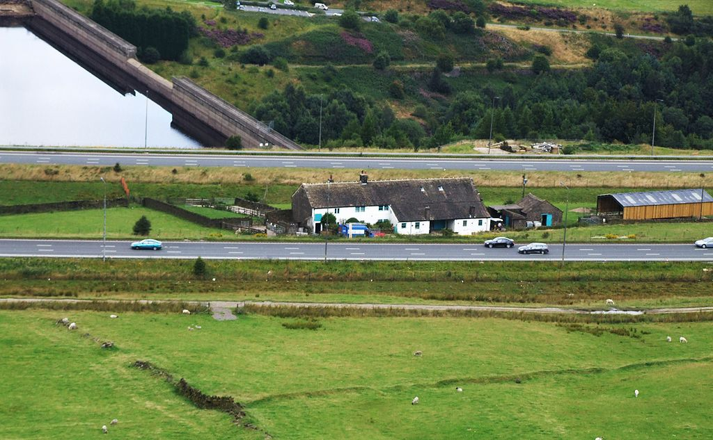 Stott Hall Farm, with stretches of M62 highway on either side. Richard Harvey, CC BY-SA 3.0 , via Wikimedia Commons