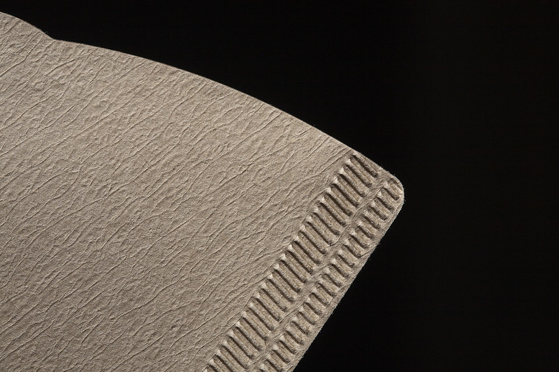 A closeup on the edge of a coffee filter. (Photo by John Lodder via Flickr/Creative Commons https://flic.kr/p/9wjrfS)