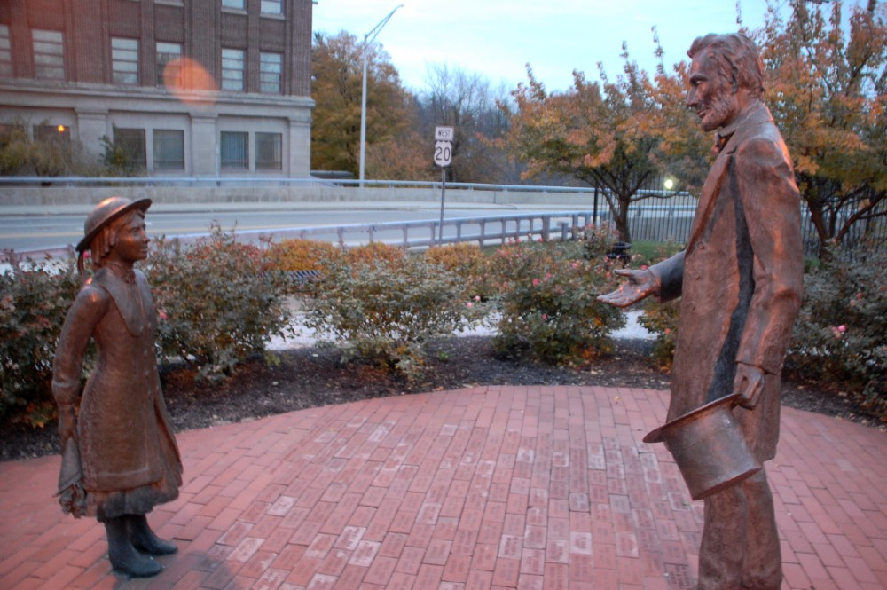 """Statues of Grace Bedell and Abraham Lincoln """"greet"""" each other in Westfield, New York."""