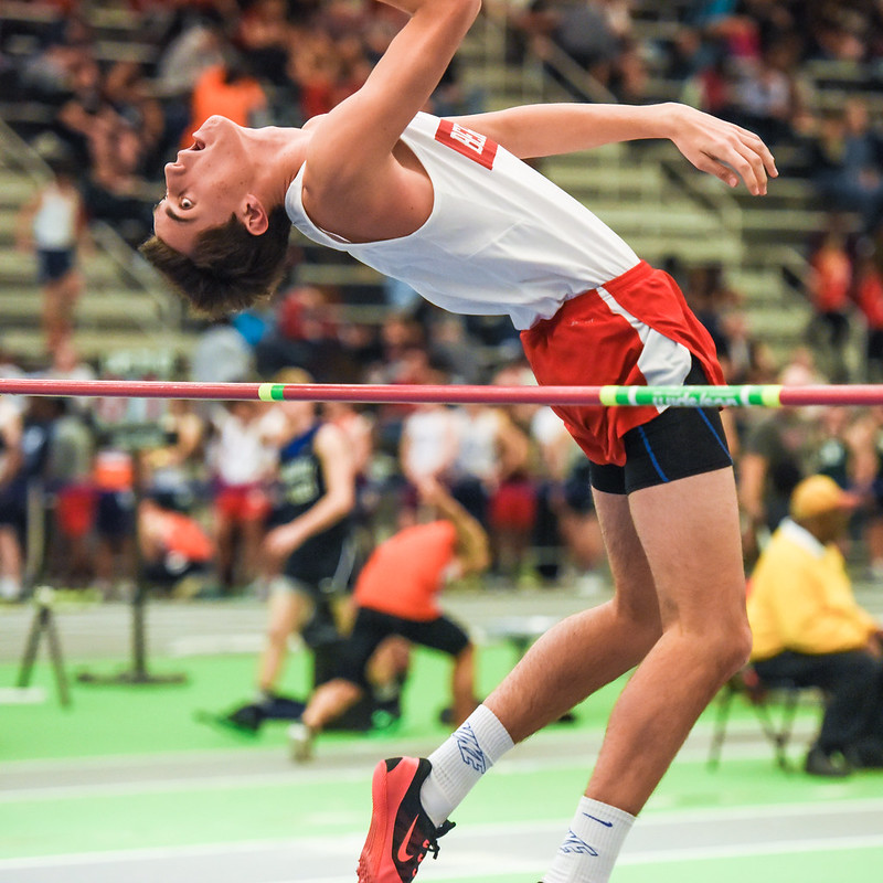 An athlete uses the Fosbury Flop to go over the bar in the high jump at the 2016 Morris County Coaches Invitational, Staten Island, NY. (Photo by Steven Pisano via Flickr/Creative Commons https://flic.kr/p/D9DmEj)